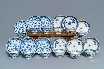 Twelve Chinese blue and white cups and saucers with floral design, Kangxi/Qianlong