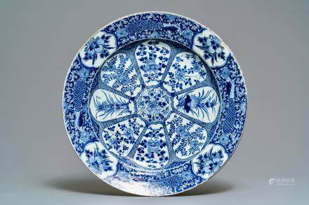 A large Chinese blue and white 'peacock border' dish, Kangxi
