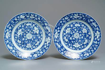 A pair of Chinese blue and white 'flower scroll' dishes, Kangxi