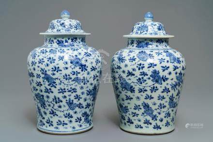 A pair of Chinese blue and white covered vases with floral design, Kangxi