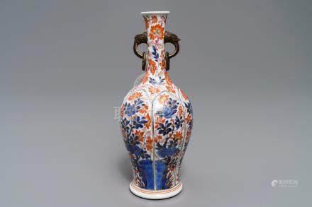 A Chinese floral Imari-style ring-handled vase, Kangxi