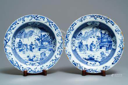 A pair of Chinese blue and white basins with figures in a garden, Yongzheng