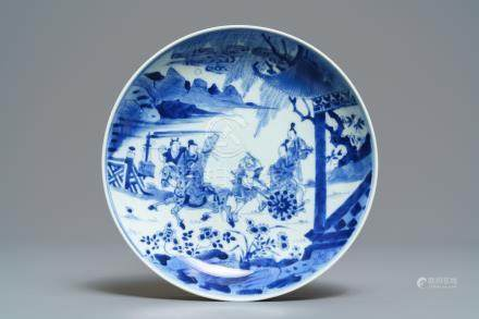 A Chinese blue and white plate with figures in a garden, Yongzheng