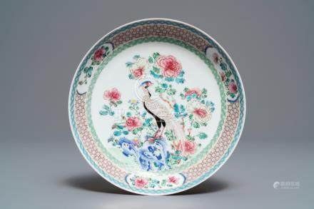 A fine Chinese famille rose 'ruby back' eggshell plate with a peacock, Yongzheng