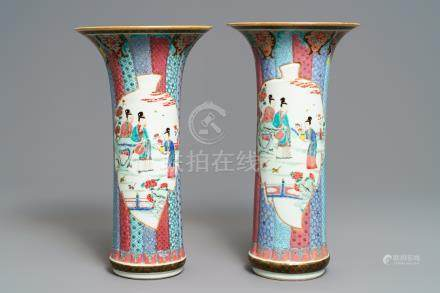 A pair of Chinese famille rose vases with ladies in a garden, Yongzheng