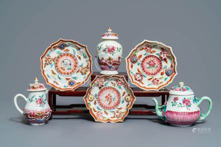 A Chinese famille rose relief-decorated teapot, milk jug and tea caddy on stands, Yongzheng