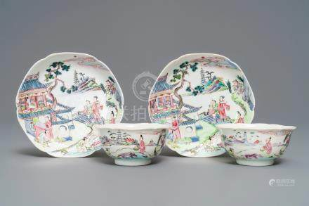 A pair of Chinese famille rose cups and saucers with figures in a landscape, Yongzheng