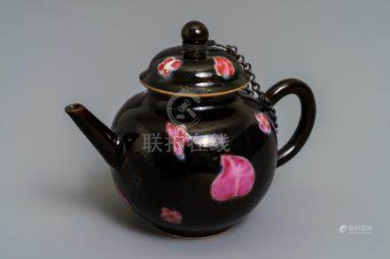 A small Chinese famille rose black-ground teapot and cover, Yongzheng/Qianlong