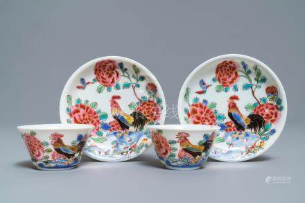 A pair of Chinese famille rose 'roosters' cups and saucers, Yongzheng/Qianlong