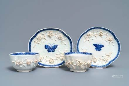 A pair of Chinese blue and white 'soft paste' relief-decorated cups and saucers, Qianlong