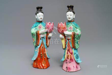 Two Chinese famille rose candle holders modelled as court ladies, Qianlong