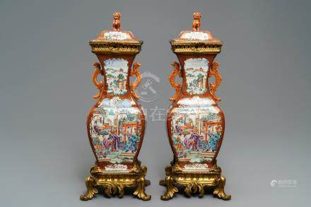 A pair of large Chinese ormolu-mounted famille rose 'mandarin' vases and covers, Qianlong