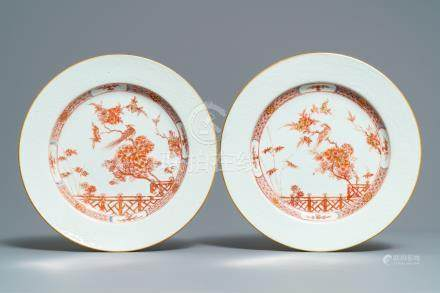A pair of Chinese iron red and gilt plates with incised underglaze design, Qianlong
