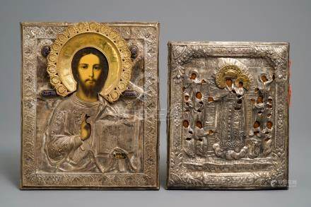 Two Russian silvered copper oklad or riza icons: 'Mother of God with apostles' and 'Pantocrator', 19th C.