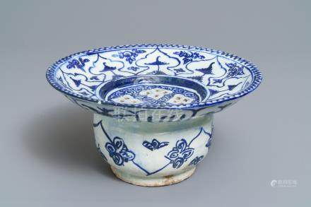 A large blue and white fritware spittoon or strainer, Qajar, Iran, 19th C.