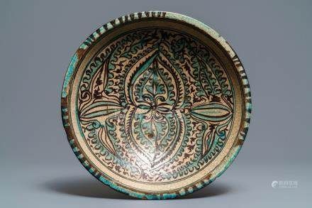 A deep Islamic pottery ornamental dish, Bukhara, Uzbekistan, 17/18th C.