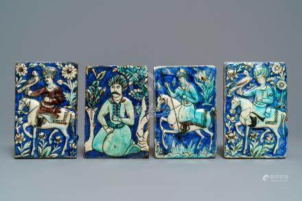 Four Qajar relief-moulded tiles with falconers, a soldier on horseback and a kneeling man, Iran, 19th C.