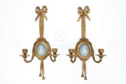 A pair of ormolu bronze wall sconces with Wedgwood Jasperware plaques, 19th C.