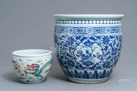 A Chinese blue and white fish bowl and a famille rose 'dragon' jardinière, 19th C. and Yongzheng