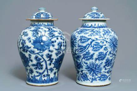 Two Chinese blue and white 'lotus scroll' vases and covers, Kangxi