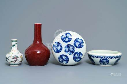 Two Chinese famille verte and sang de boeuf vases and a blue and white 'cranes' box, 19th C.
