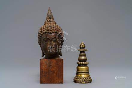 A Tibetan gilt bronze stupa and a lacquered bronze Buddha head, Laos, 16/17th C.