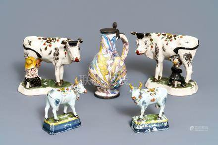 Two pairs of Dutch Delft cows and a pewter-mounted Habaner jug, 18th C.