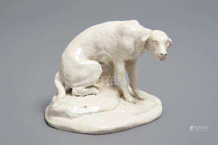 A white Dutch Delft model of a dog, 18th C.