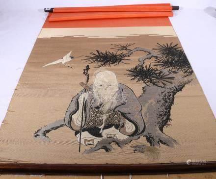 A Kesi scroll panel depicting Fukurukuju standing by a pine tree with a crane, 117 x 52 cm.