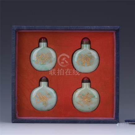 FOUR CHINESE GOLD PAINTED JADEITE SNUFF BOTTLES