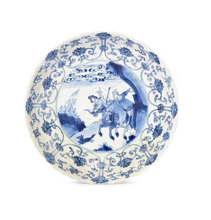 A Chinese porcelain saucer dish, Chenghua mark, Kangxi period, painted in underglaze blue to the