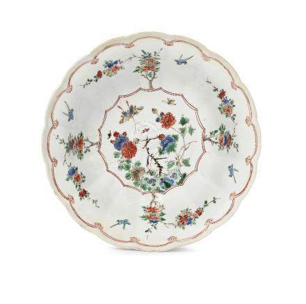 A Chinese porcelain lobed bowl, Chenghua mark, Kangxi, painted in famille rose enamels to the