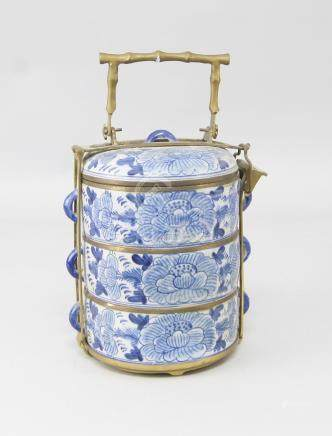 A modern Chinese stacked porcelain and metal bound food container, late 20th/21st Century, with