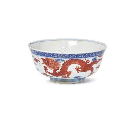 A Chinese porcelain bowl, Kangxi mark, late Qing dynasty, painted in underglaze blue and overglaze