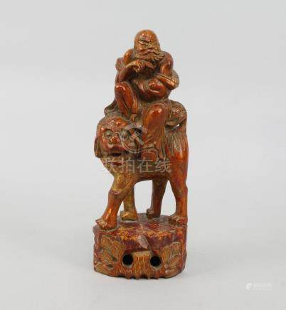A Chinese hardwood figure of a bearded sage, late 19th/early 20th century, modelled seated on a