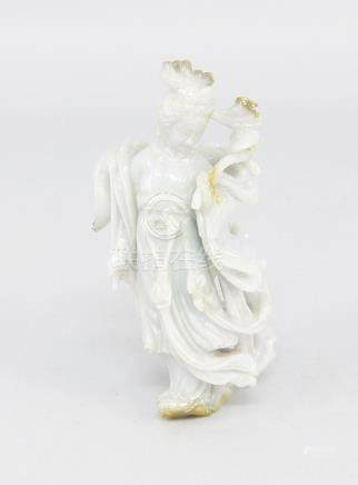 A Chinese carved lavender and rust jade young lady, late 20th century, wearing a long scarf and