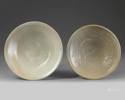 Two Chinese celadon-glazed carved bowls