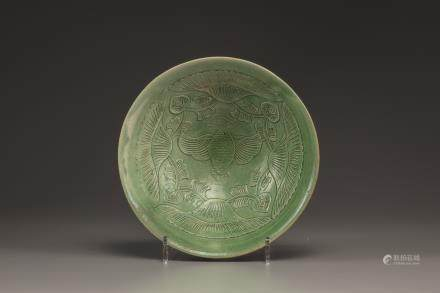 A Yaozhou carved green glazed conical bowl