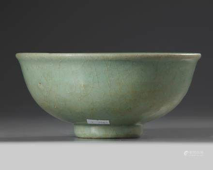 A Chinese Longquan celadon moulded 'floral' bowl