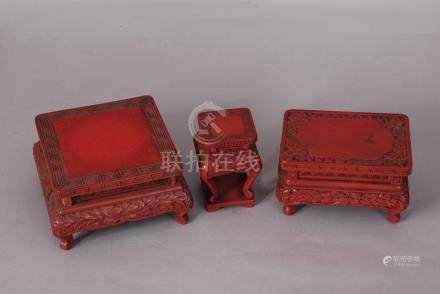 Three C19th Chinese carved cinnabar lacquer stands, 15cm wide max (3)