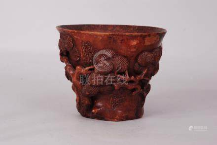 Chinese bamboo libation cup carved and pierced as a gnarled pine trunk with foliate branches, 11.2cm