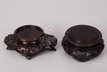 Two Chinese carved Zitan stands, one bearing 'John Sparks Ltd' label (2)