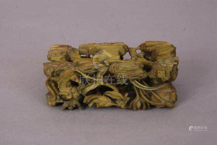 C18th Chinese stained ivory stand, carved and pierced with chilong, rocks, bamboo and lotus flowers,