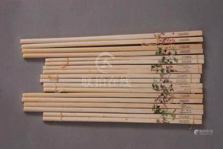 Nine pairs of Chinese ivory chopsticks decorated with cranes, birds and landscapes. (9)