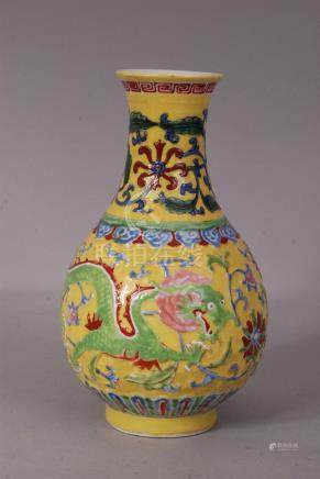 C18th Chinese yellow ground famille rose vase, decorated with dragon in flight amongst lotus and
