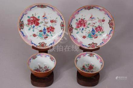 A pair of Chinese café-au-lait glazed famille rose cups and saucers decorated with peonies,