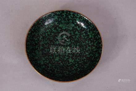 Chinese black-ground green-glazed 'lotus scroll' dish, the exterior decorated with five bats in