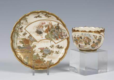 A Japanese Satsuma earthenware cabinet cup and saucer by Kaizan, Meiji period, the cup exterior