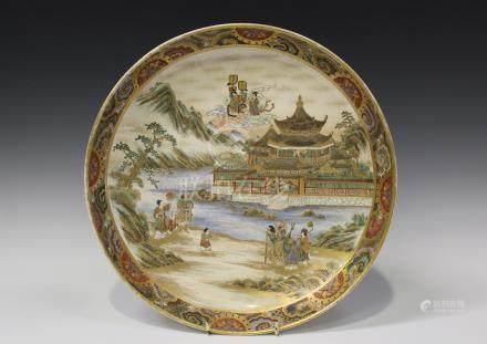 A Japanese Satsuma earthenware circular dish by Gyokusan, Meiji period, the interior painted and