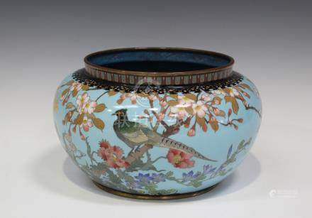 A Japanese cloisonné bowl, Meiji period, of compressed circular form, the body decorated with a